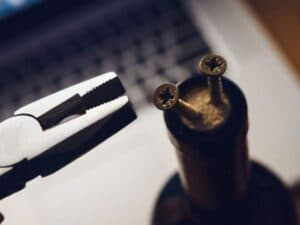 how to remove corkscrew with pliers and a screw